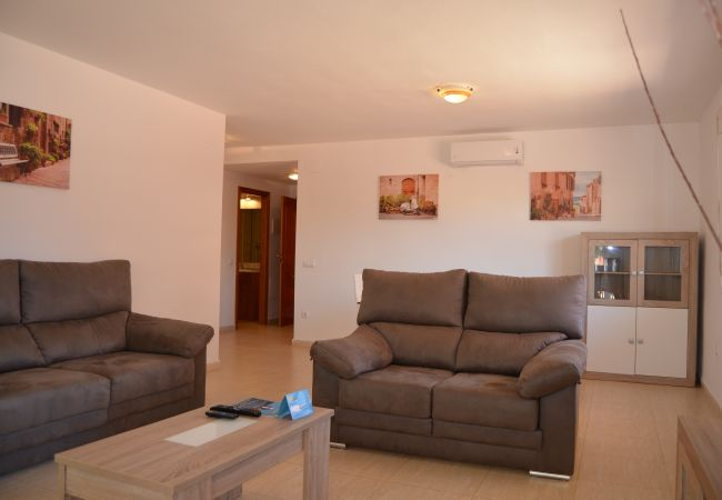 Fully furnished living room in apartment rental - Resort Choice