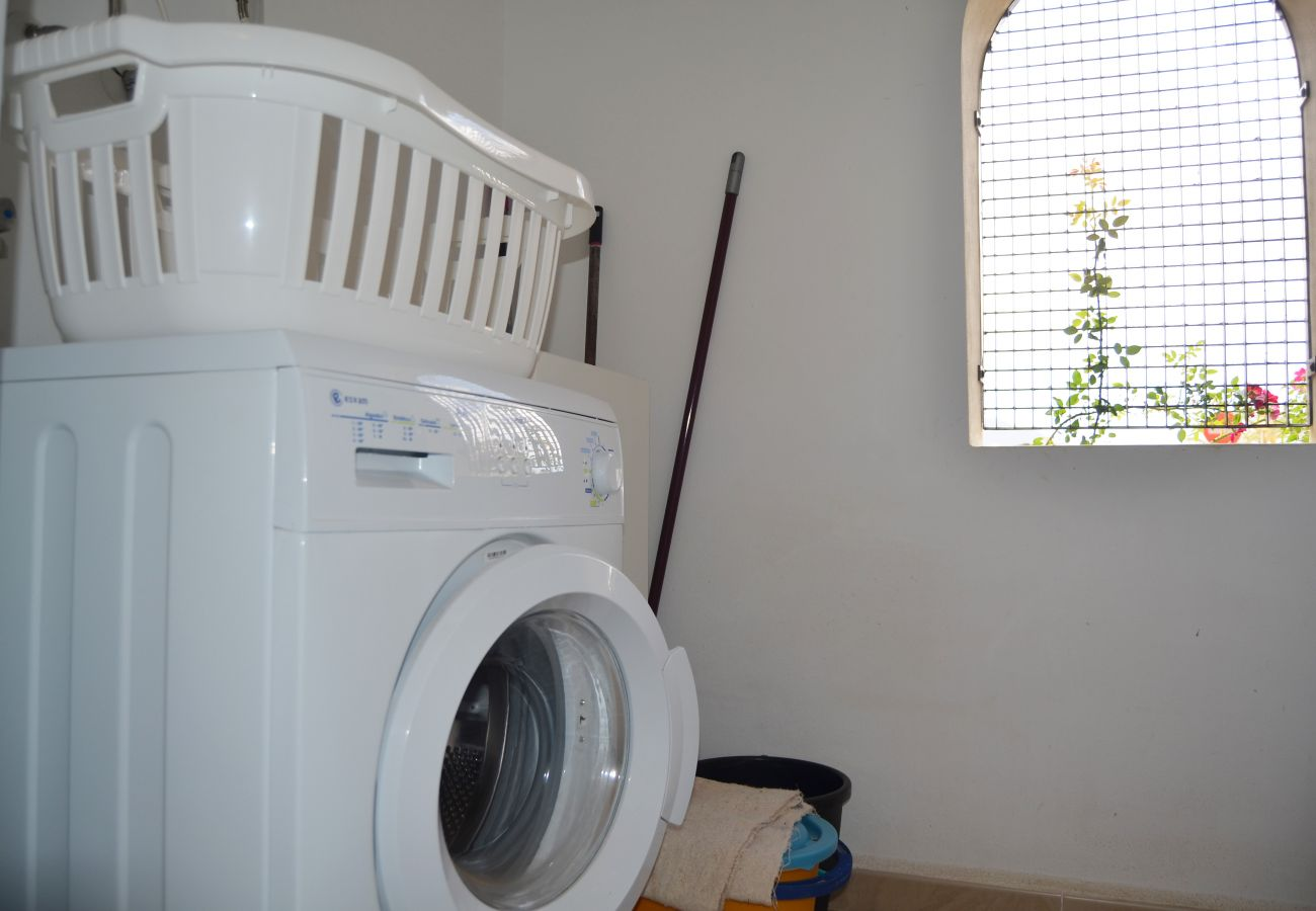 Utility room with modern electronic washing machine - Resort Choice