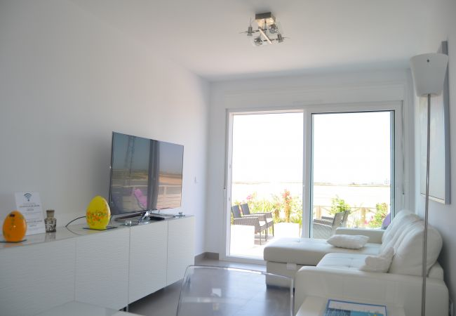 Luxurious airy living room with T.V in La Manga Apartment