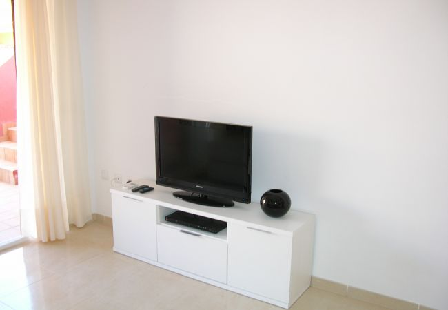 Living room equipped with T.V and furniture - Resort Choice