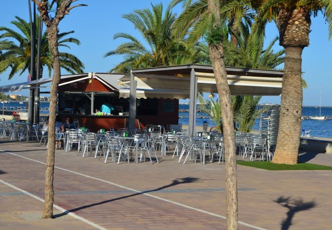 Santiago de la Ribera promenade with lots bars