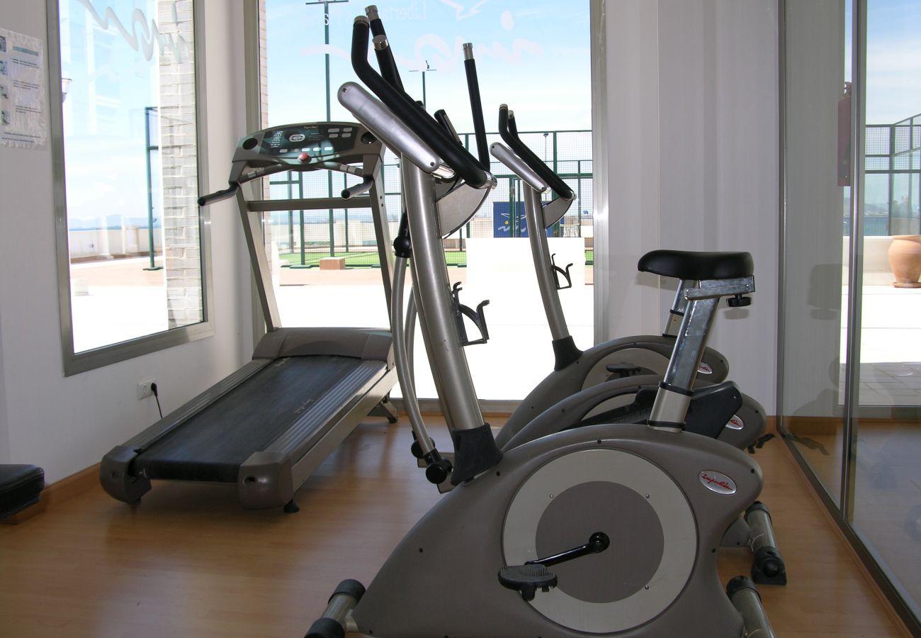 Modern gym at Libertad Dos Playas apartment