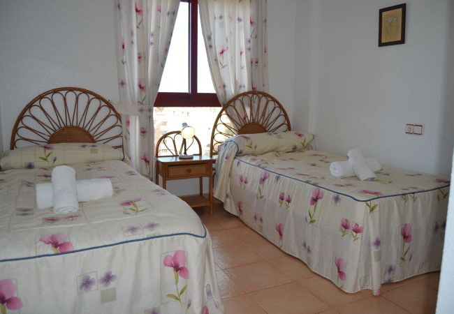 Lovely Bedroom of Verdemar Apartment