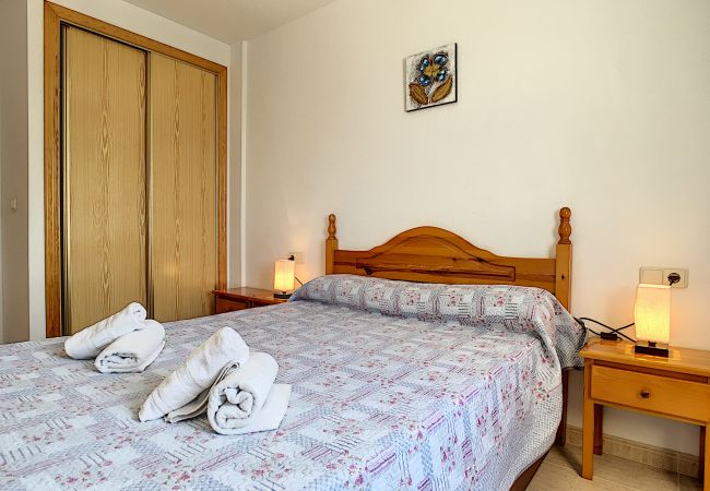 main bedroom with double bed, wardrobe and ceiling fans
