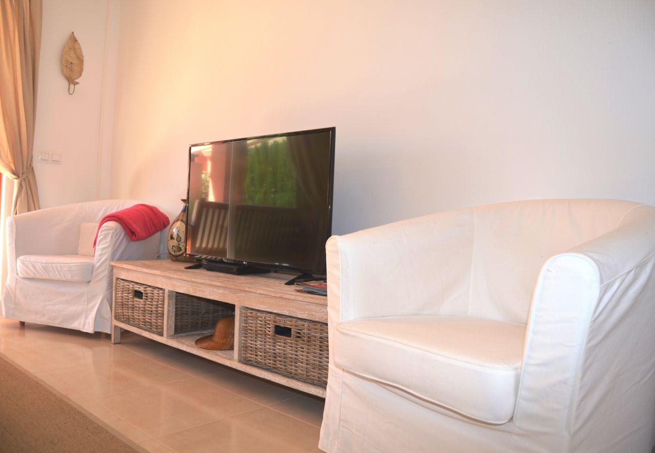 Modern living room with TV - Resort Choice