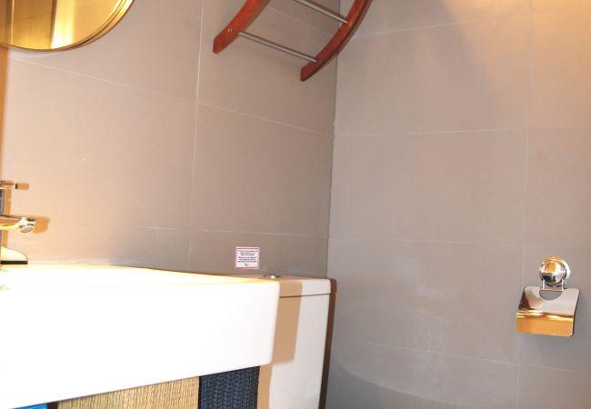 Bathroom with modern bath ware appliances - Resort Choice