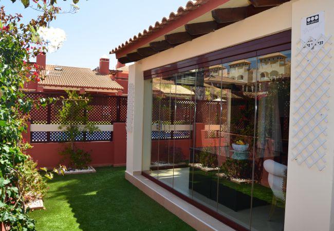 Poolside house's inbound exterior with garden - Resort Choice