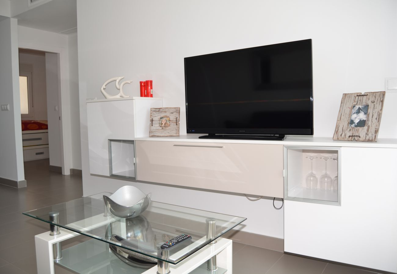 Modern living room equipped with T.V and comfortable furniture